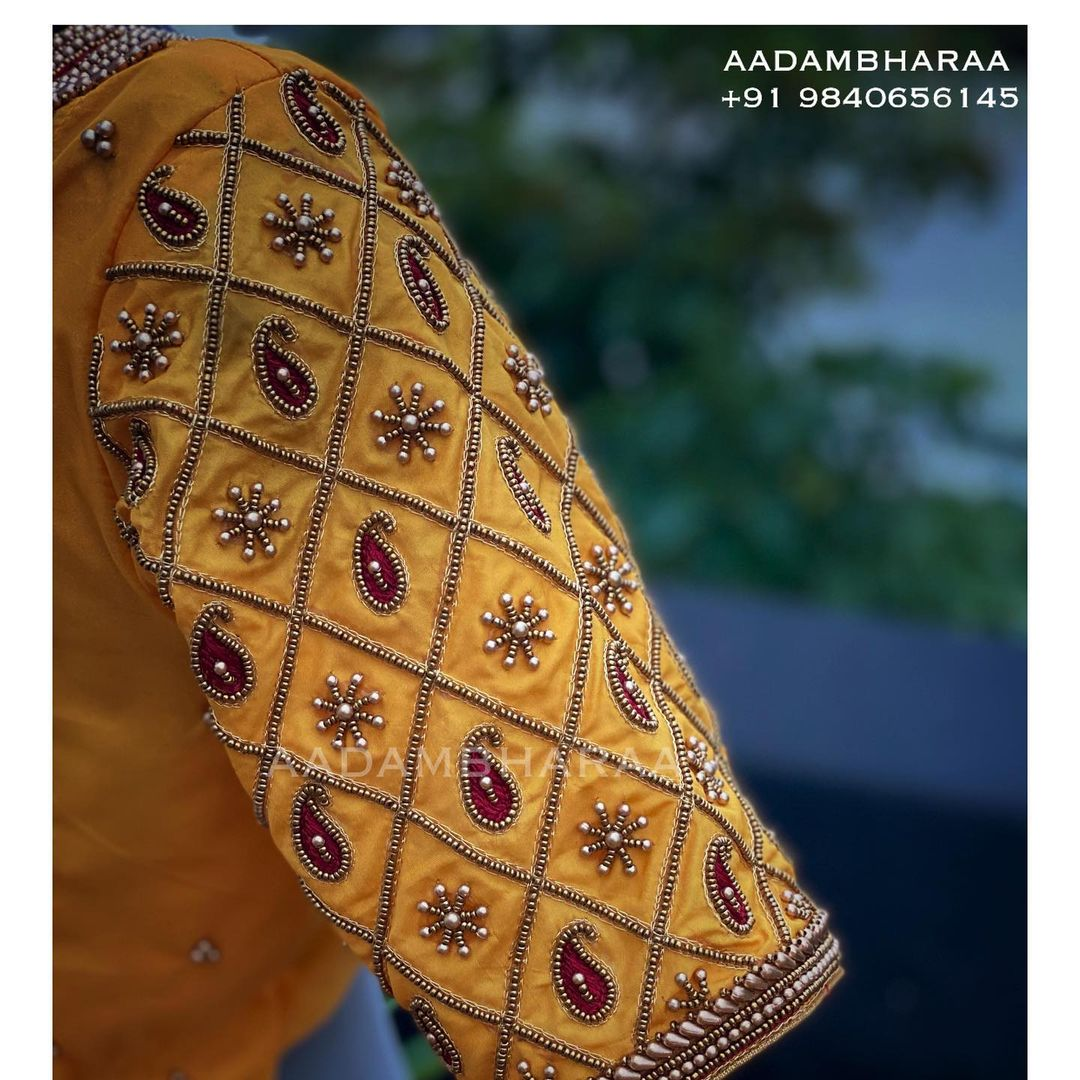 Stunning mustard yellow color bridal blouse sleeves with grid mango and buti ahdne embroidery bead aari work.   2021-06-18