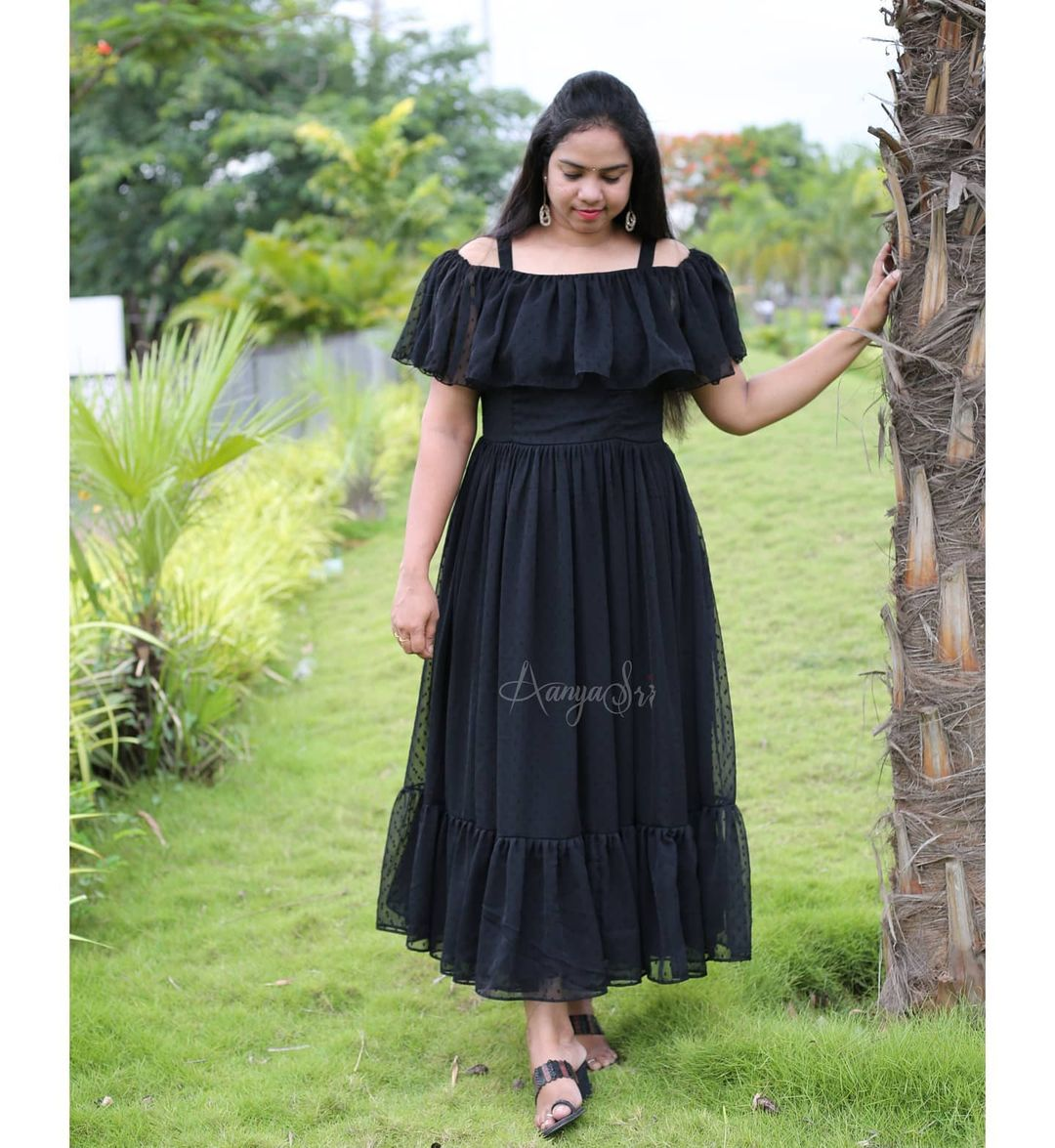 Black layered ankle length frock with off shoulder pattern  comes with detachable shoulder straps  cups(by default) and double lining. Kokila. Price :  RS. 2600. 2021-06-18