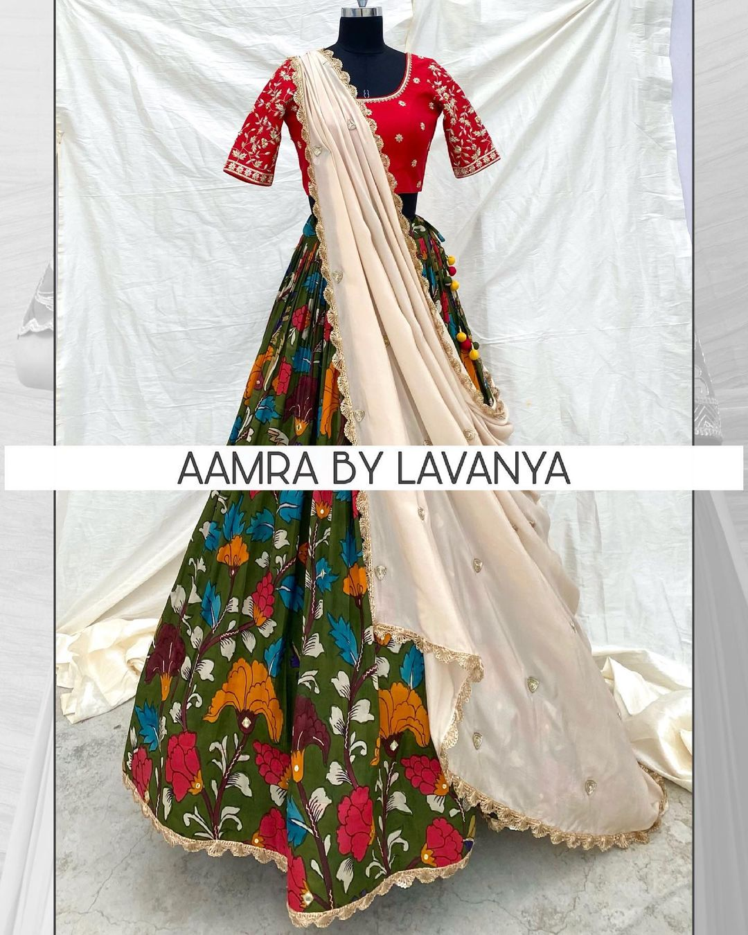 Hand painted and hand embroidered pen kalamkari silk lehenga paired with an all over hand embroidered blouse and ivory dupatta. For orders and queries call/whatsapp on +91-9177363970. 2021-06-19