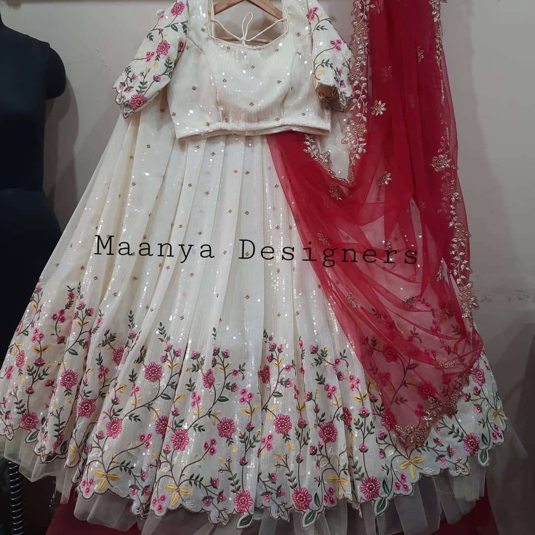 Custom made sequins lehenga For price details . Stunning pearl white color lehenga and blouse with net dupatta. Lehenga and blouse with floral sequin hand embroidery work.  contact/watsapp on +917799503713 2021-06-20