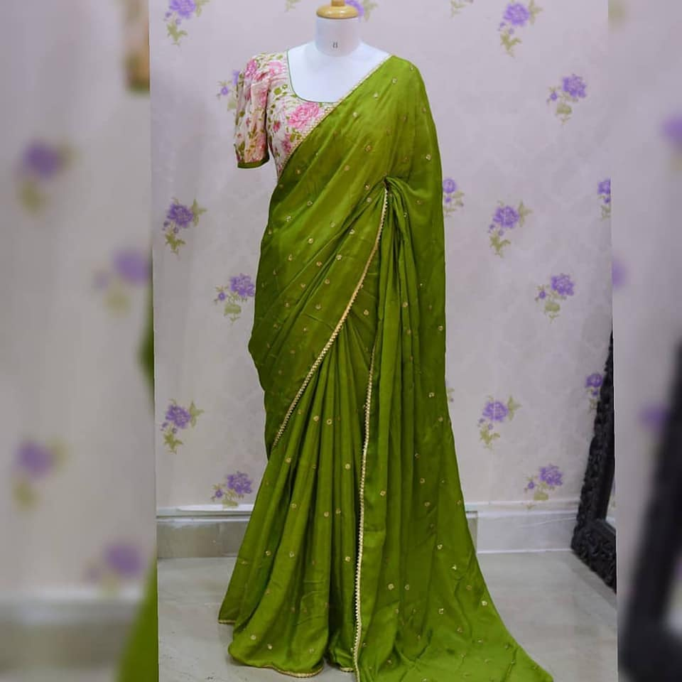 Mehandhi green pure chinon saree with all over butis paired up with Beautiful floral blouse. Blouse sizes can be customized.  Price: 4200+₹ 2021-06-20