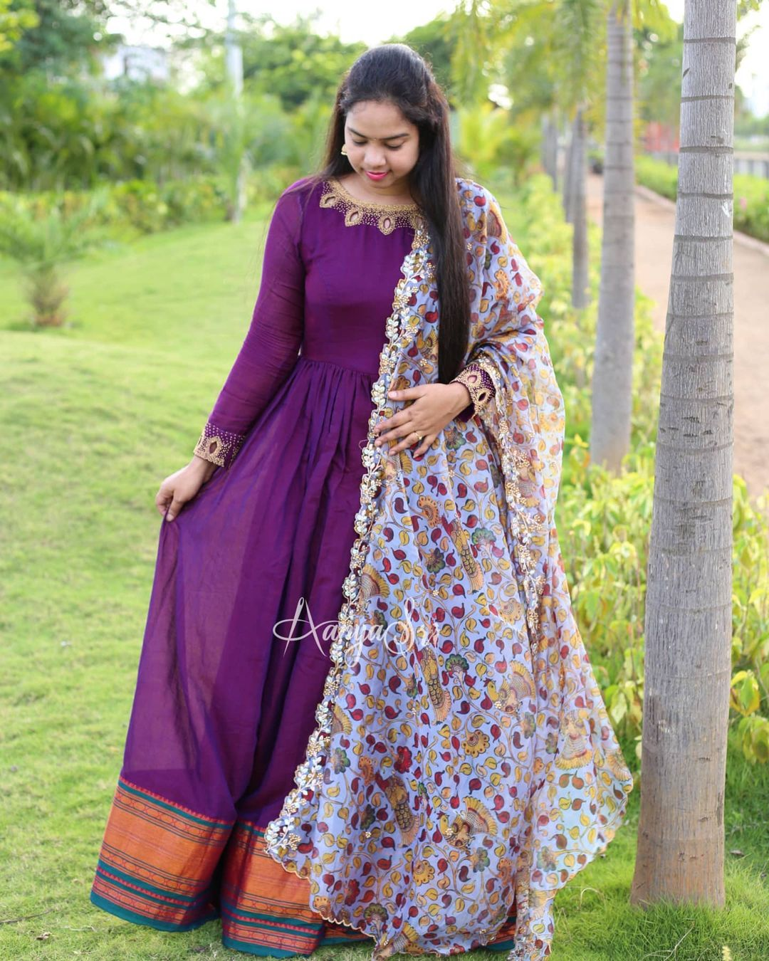 Purple Kalamkari. Price : RS. 4950. Purple handloom long frock with an intricate neckline handwork detailing and petals cutwork yoke paired with a beautiful organza printed kalamkari cutwork dupatta . Truly a must have in your wardrobe !! 2021-06-20