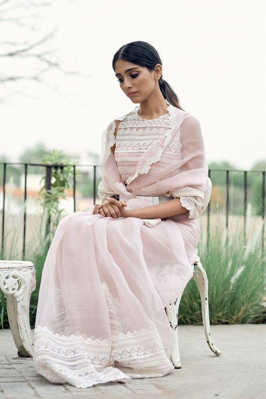 organza lace sari and lace embroidered blouse !! An integration of time-honoured craftsmanship and creativity • Featured here Pink organza lace sari and lace embroidered blouse paired with our classic bow belt. 2021-06-21