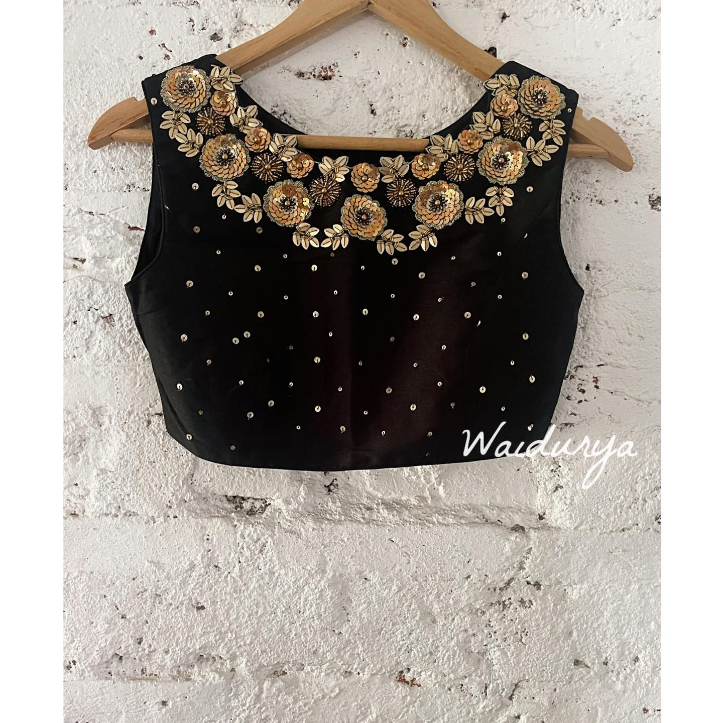 Stunning black sleeveless blouse design with hand embroidery zardosi and multi sequin work.  2021-06-21