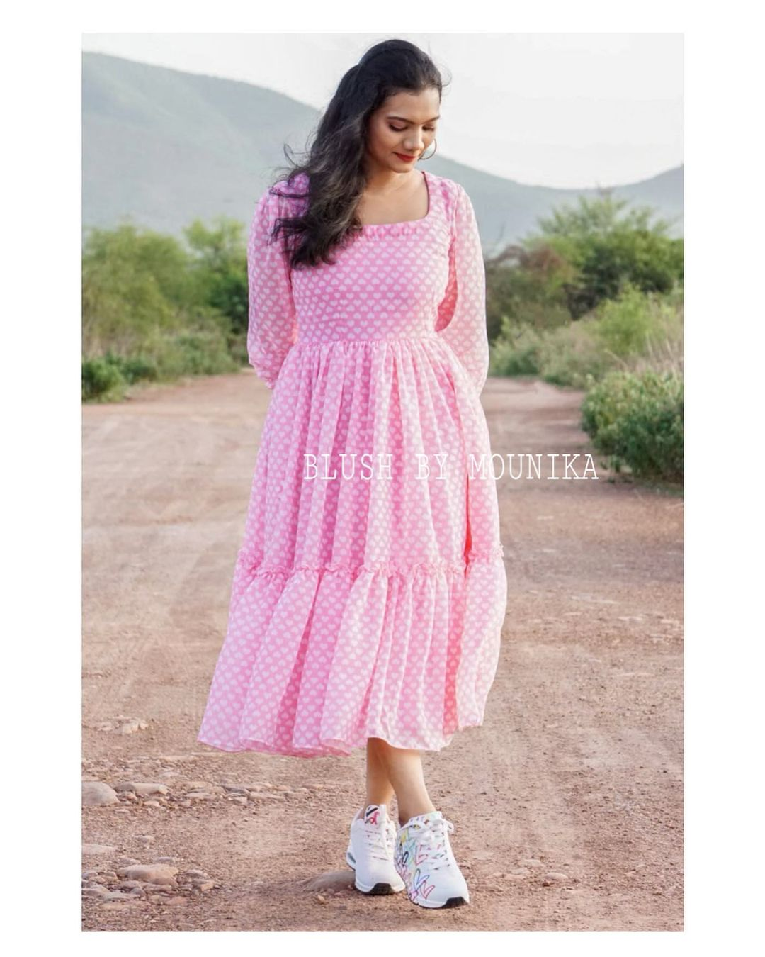 Pink and blue georgette frock with heart print. The dress has elasticated balloon sleeves and ruffled flare. 2021-06-21