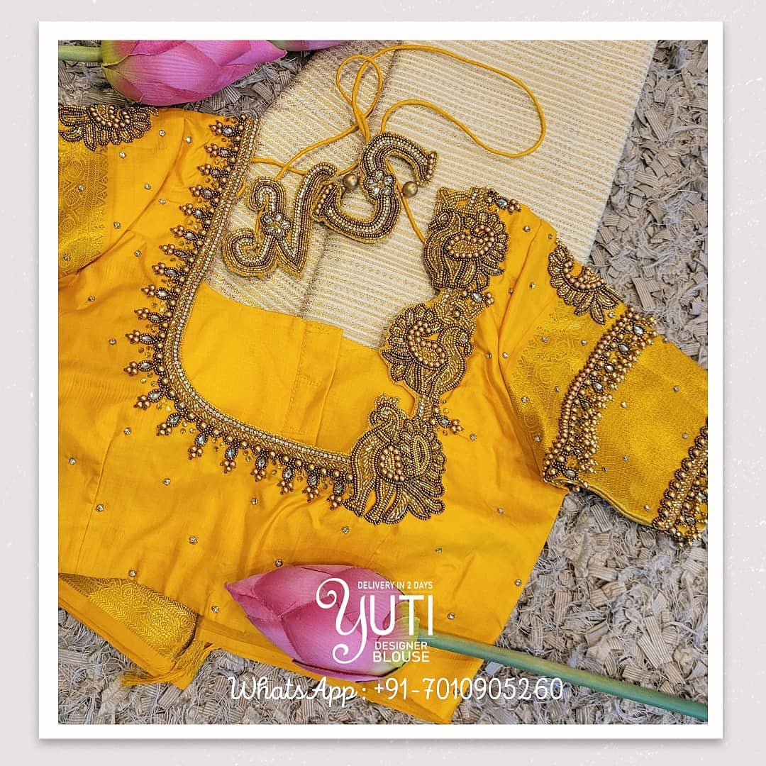 Stunning yellow bridal blouse design with swan motif hand embroidery bead aari work.  2021-06-21