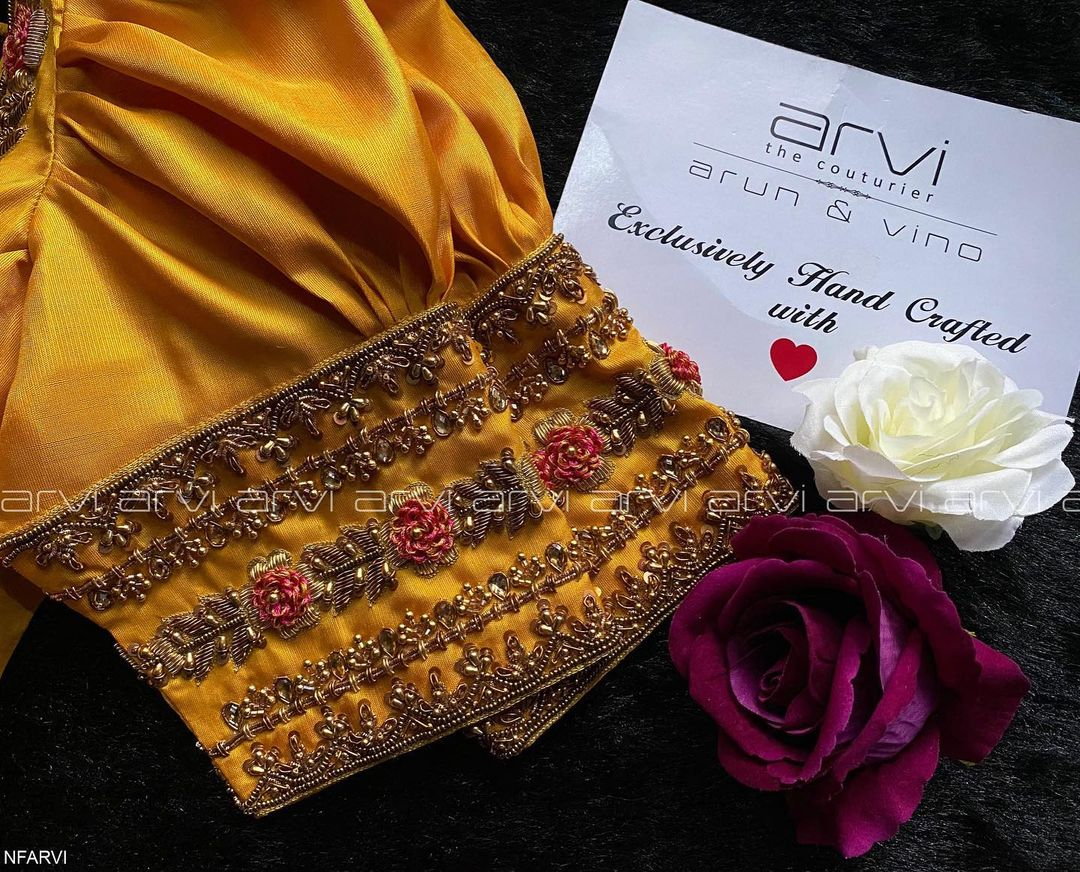 Stunning mustard yellow color  bridal blouse design with floral hand embroidery maggam and zardosi work.  2021-06-21