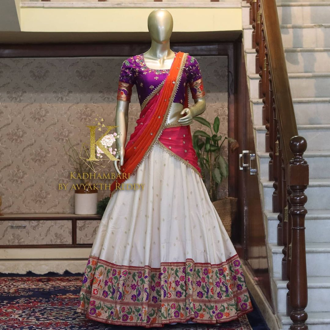 Stunning pearl white color paithani lehenga and purple blouse with net dupatta. Blouse with hand embroidery work.  This outfit is Available at 14800/- 2021-06-21