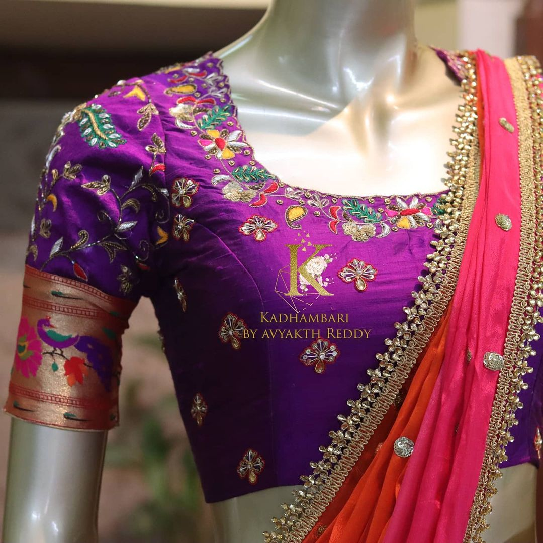 Stunning purple color bridal blouse design with floral creeper hand embroidery zardosi maggam work on neckline. Blouse with paithani sleeves.  2021-06-21