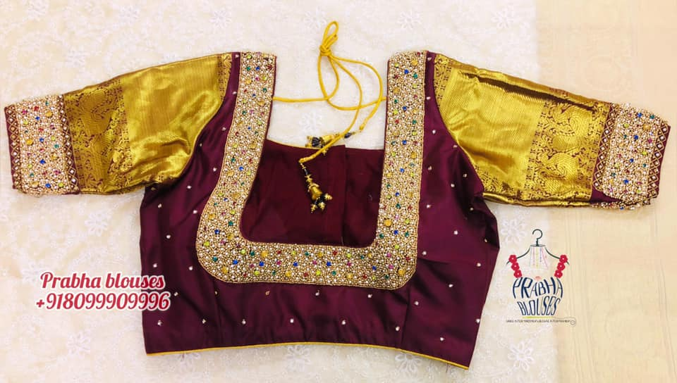 Stunning thick wine color bridal blouse with multi color bead and stone hand embroidery work on neckline.. Blosue with gold sleeves.   2021-06-22