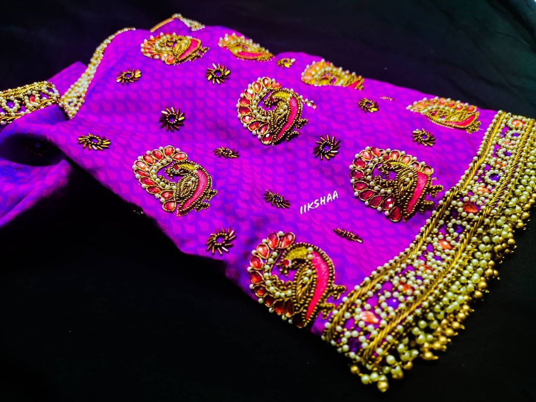 Stunning purple color blouse with peacock motif hand embroidery bead aari work.  2021-06-22