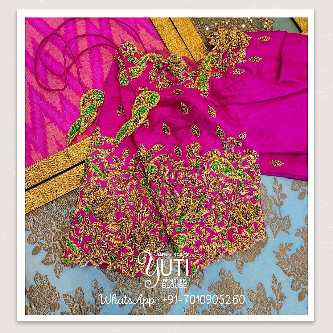 Lovely pink color bridal blouse design with parrots and lotus hand embroidery maggam work. Blouse with parrot tassels.  2021-06-22