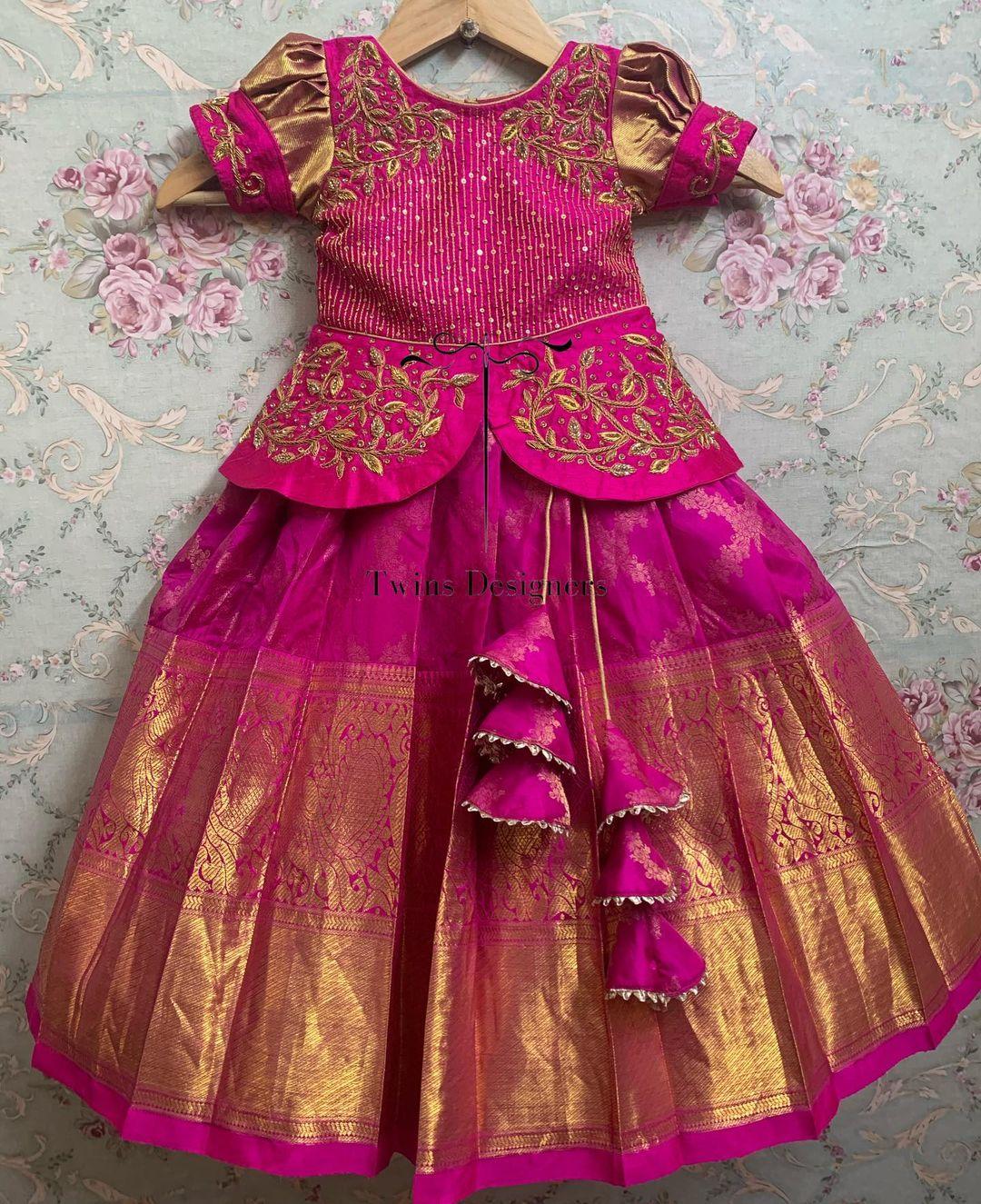 Stunning pink colour kids kanchi pattu lehenga and peplum top. Top with hand embroidery work.  2021-06-22