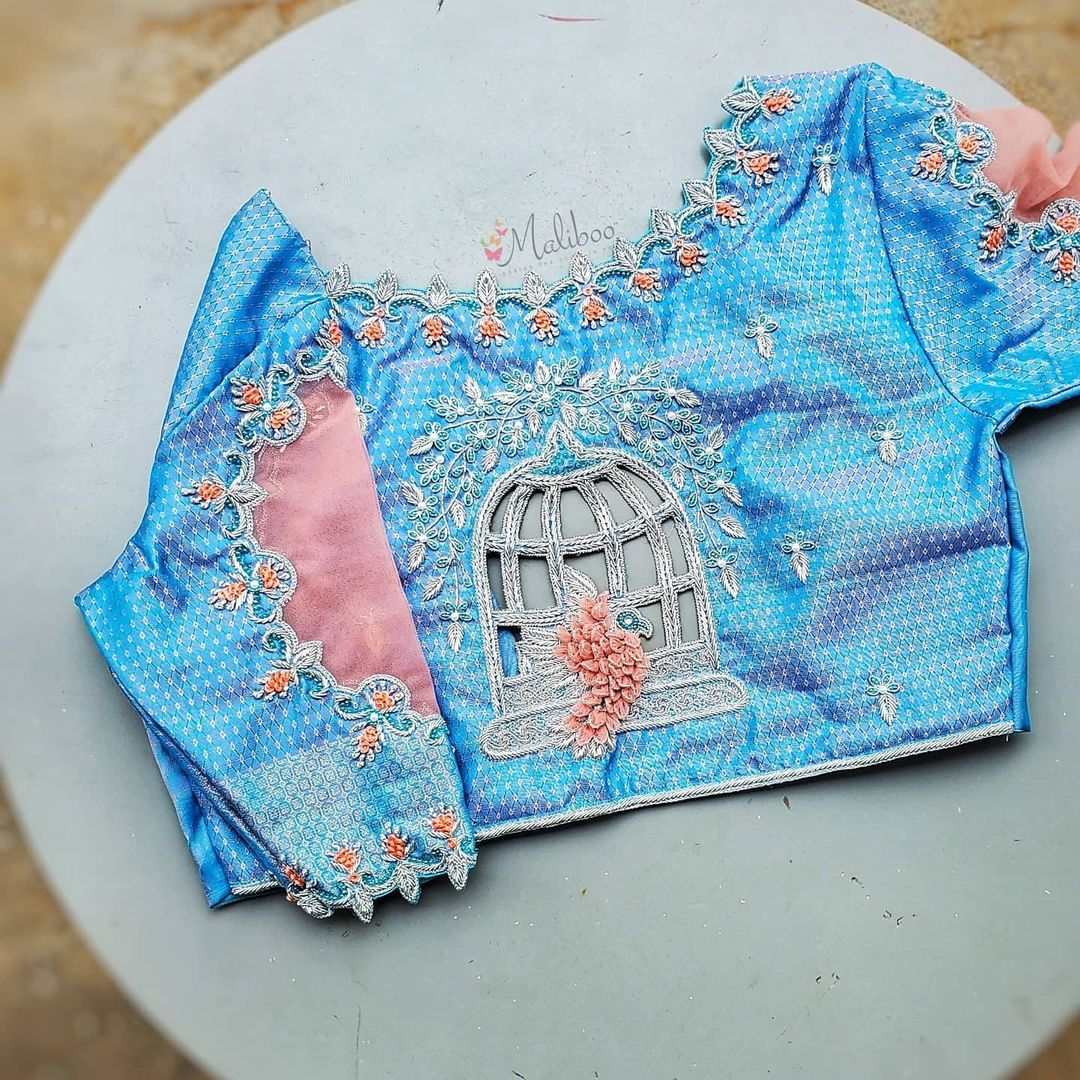When you keep it simple make it blue. Gorgeous blue color bridal blouse with bird and cage design hand embroidery work on back. Blouse with sheer and cut work on sleeves.  2021-06-22