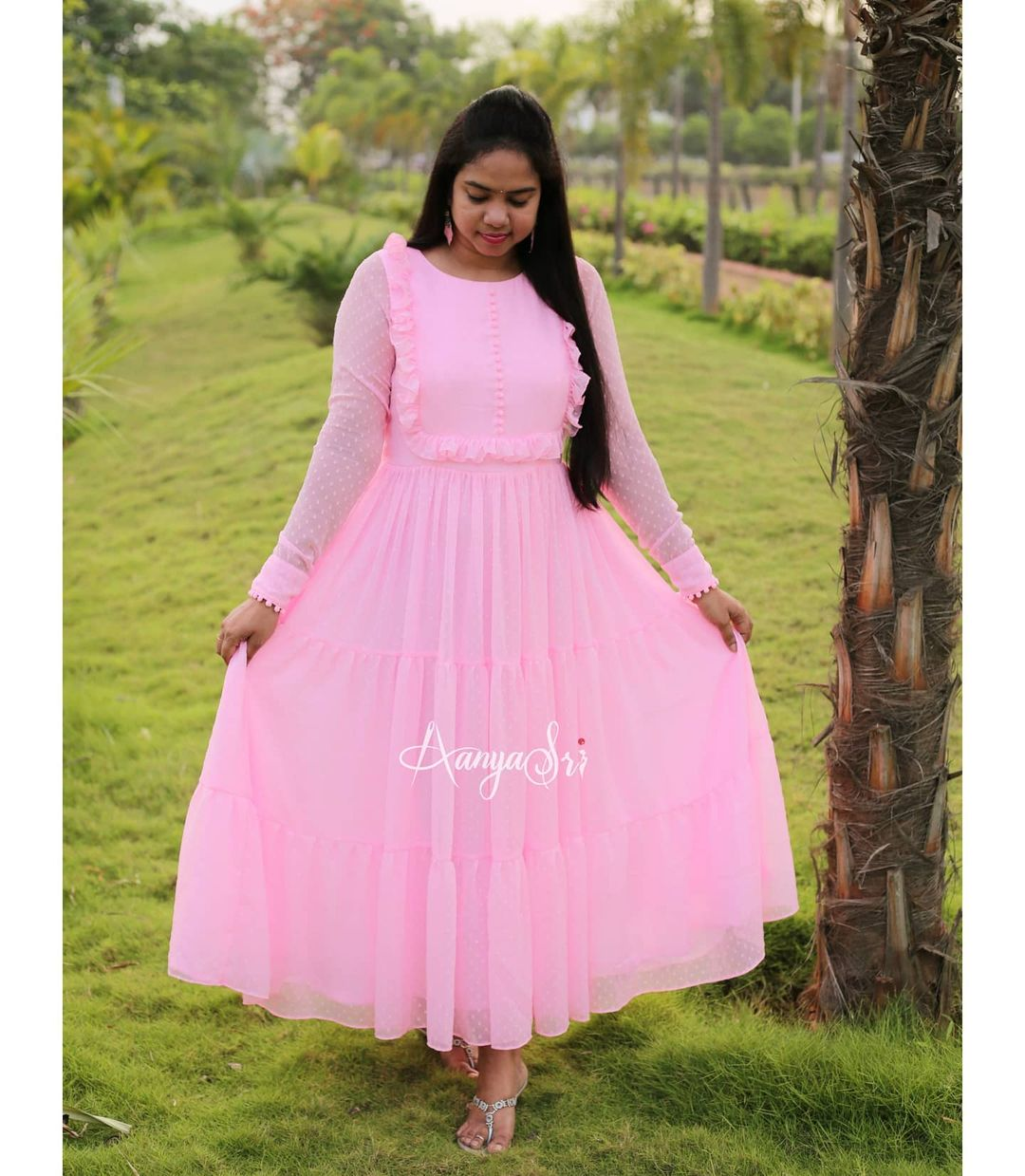 Candy Pink layered ankle length frock with ruffle & potlis detailing on the yoke . Comes with full sleeves and potlis on the sleeves and boat neck. Candy Pink. Price : RS. 2600. 2021-06-22