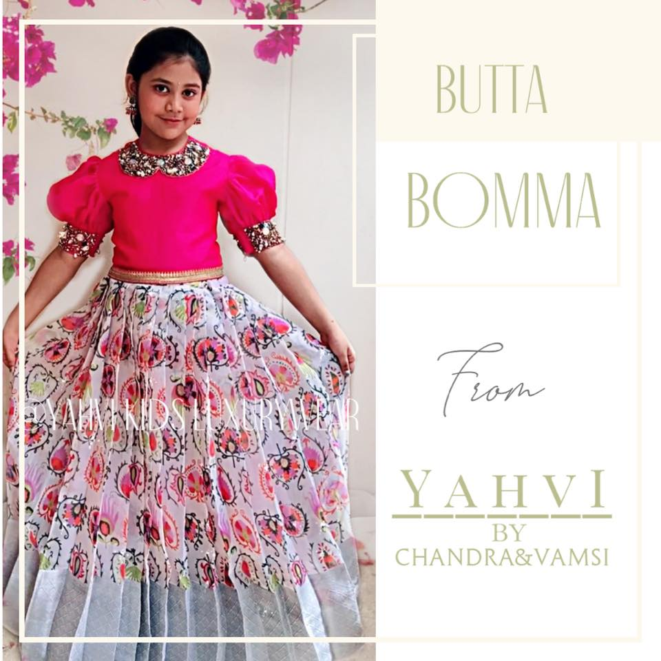 Butta bomma series . Look trendy in  pink  long top in heavy embroidery work and jute Lenin kids skirt in beautiful multi colour floral motifs and silver Kanjeevaram style border .  2021-06-23