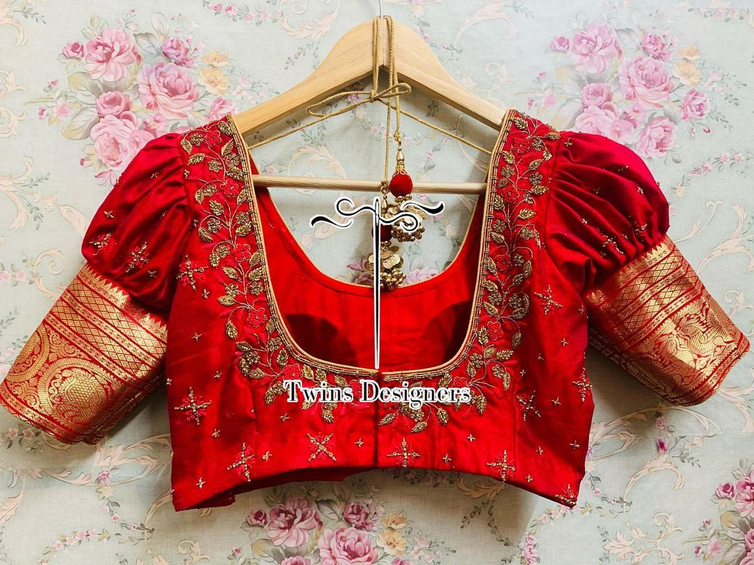 Stunning red color puff sleeve zari boarder blouse with hand embroidery creeper maggam work. 2021-06-23