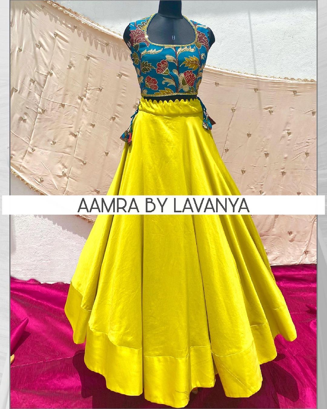 Hand painted and hand embroidered pen kalamkari silk croptop paired with a mint yellow flared skirt. For orders and queries call/whatsapp on +91-9177363970 2021-06-23