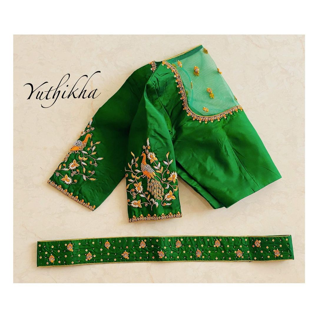 Simple & Elegant Net embroidery blouse cum waistbelt. Beautiful green color net sheer back blouse with peacock hand embroidery maggam work on sleeves.   2021-06-23
