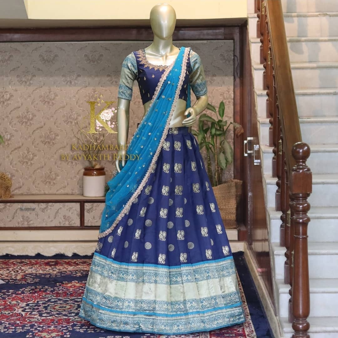 Beautiful deep blue color silver pattu lehenga and blouse with net dupatta. Blouse with hand embroidery work.   This outfit is Available at RS 11800/- 2021-06-23