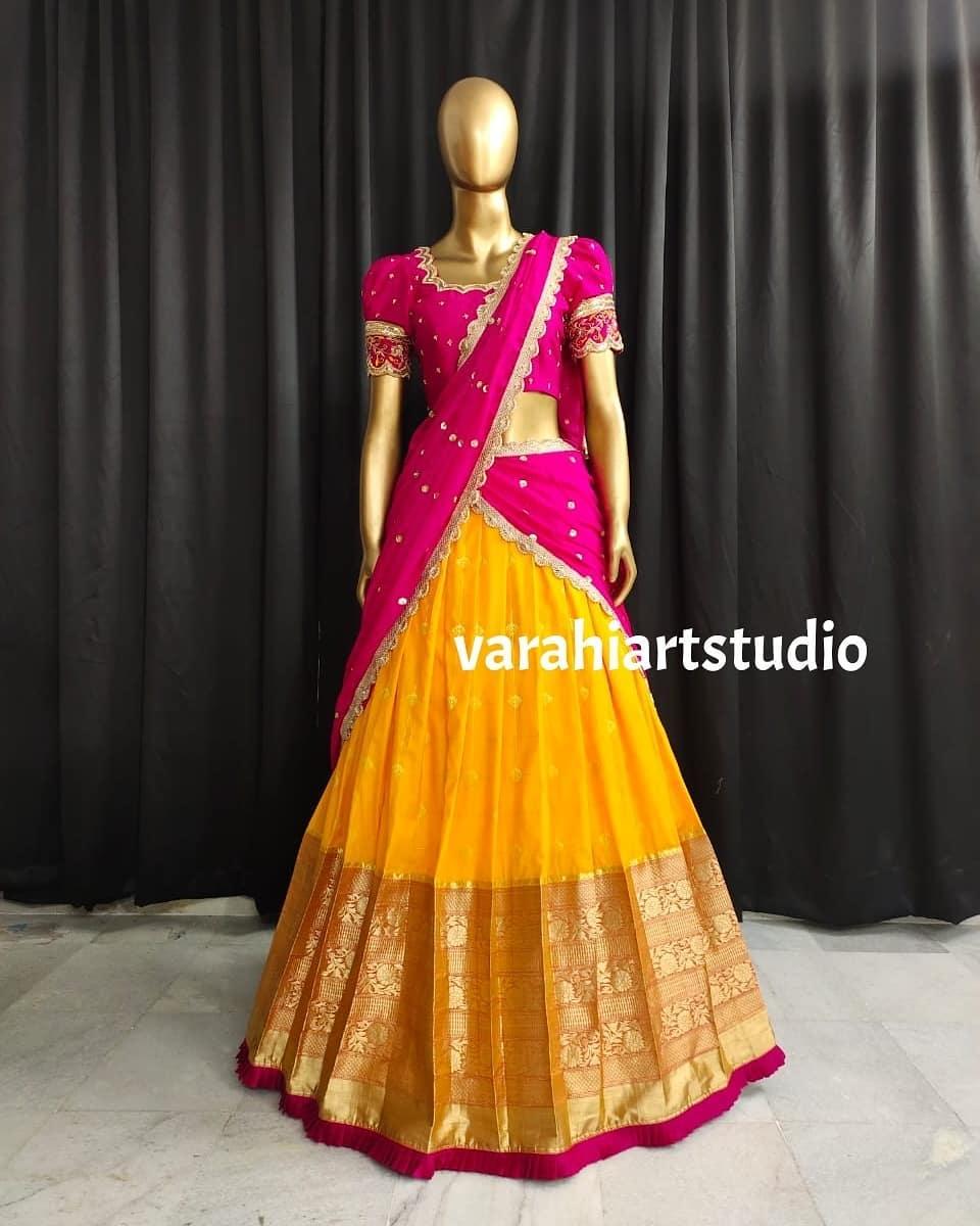 Beautiful yellow color pattu lehenga and pink blouse with net dupatta. 2021-06-24
