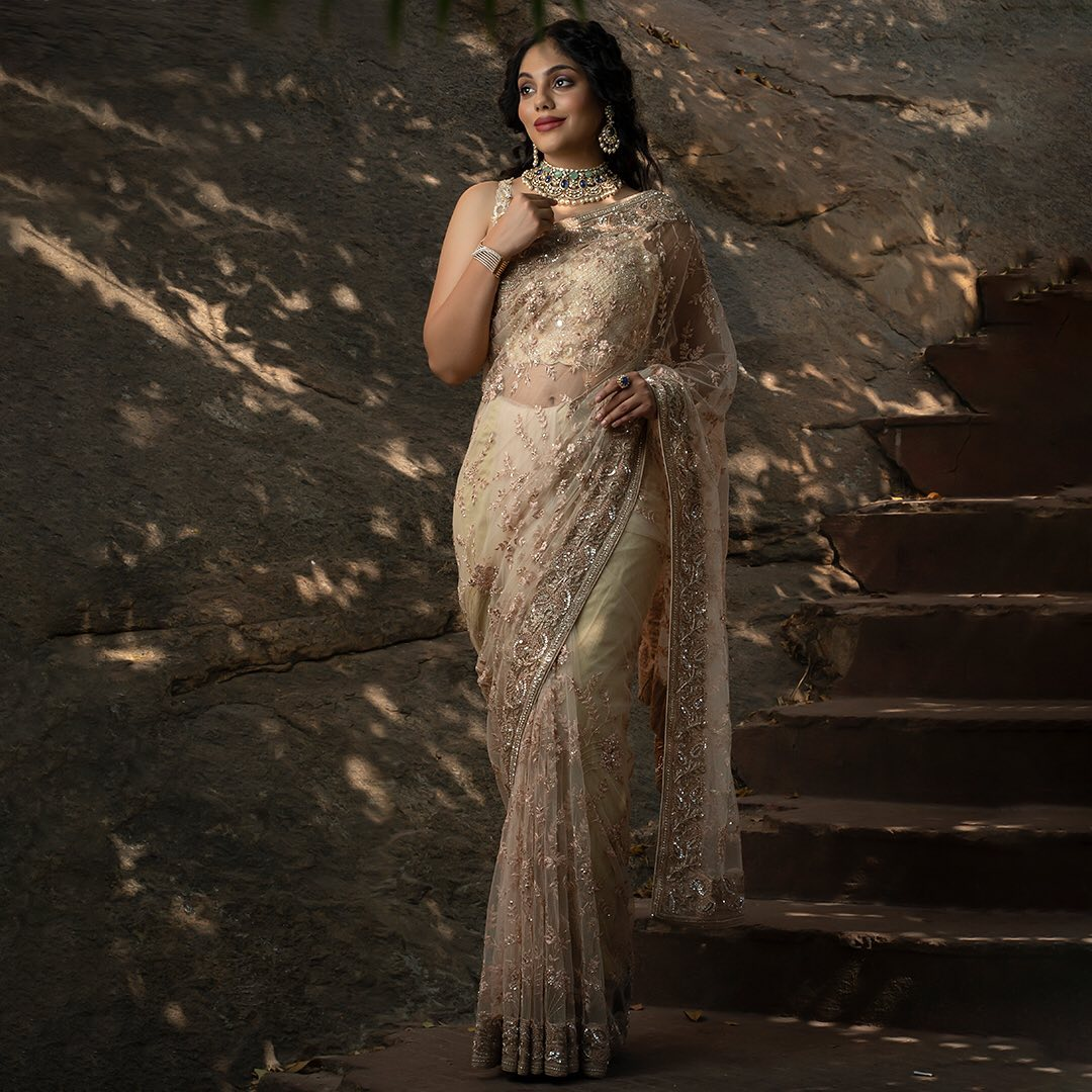 With  Designer saree collection you may have a striking look. Presenting you this flawless Net saree that will quickly brighten your emotions with a mix of Oat Beige and captivating art of embroidery with rich embellishments. With an exceptional masterpiece enjoy the feel of fabric and the richness of this extraordinary handcrafted designer saree for a perfect go. 2021-06-24