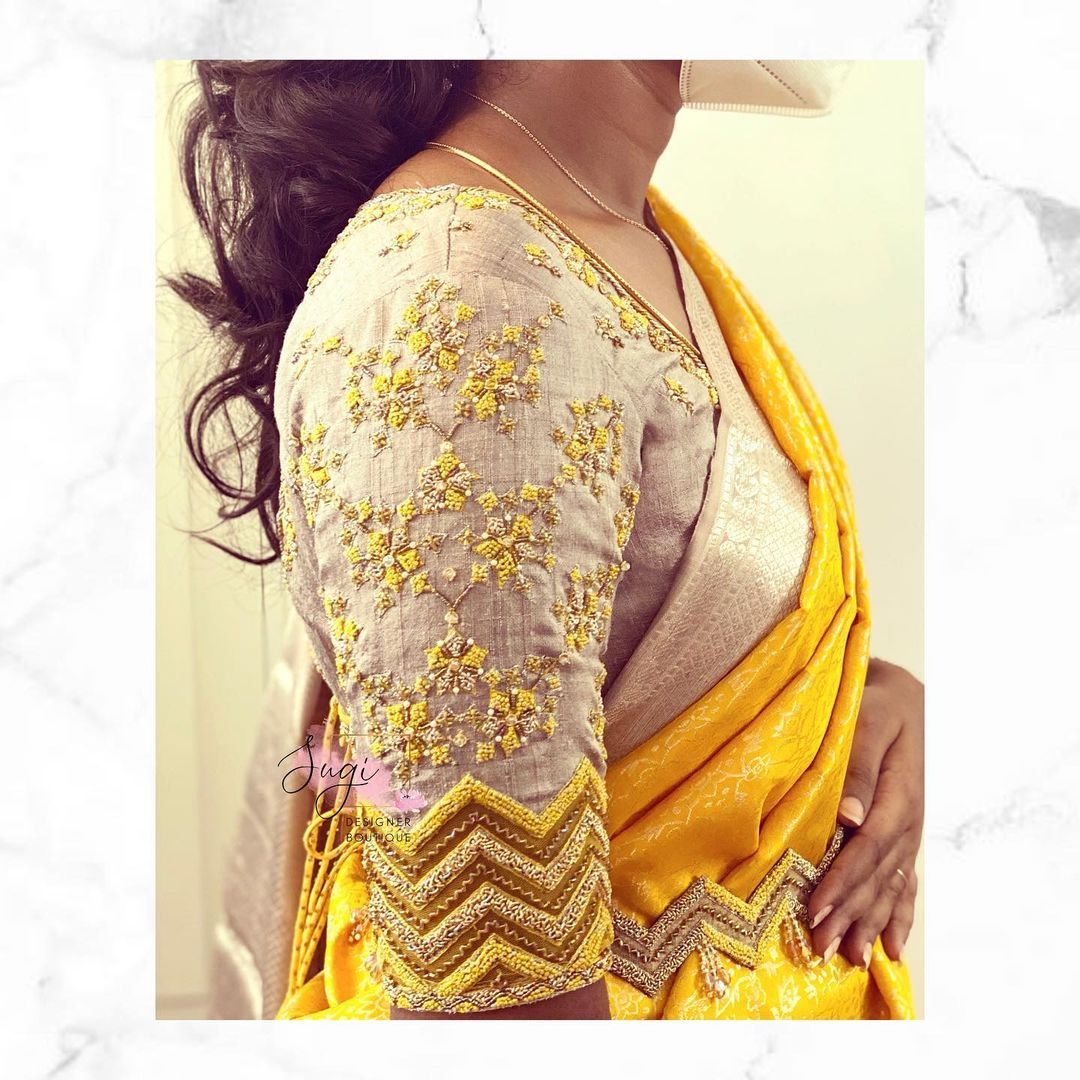 Beautiful gold shade designer blouse sleeve with  yellow and gold bead aari work. 2021-06-25