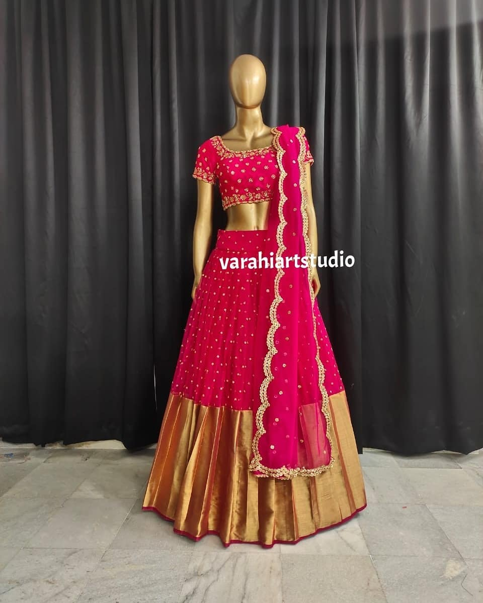 Stunning pink color net bridal lehenga with big gold jari boarder. Blouse with hand embroidery work and net dupatta.   2021-06-25