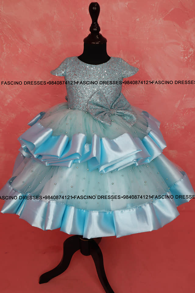 A beautiful blue sequin pearl layered baby gown from Fascino . Wats app or inbox to order 9840874121.. Can customize in any color / size. 2021-06-27