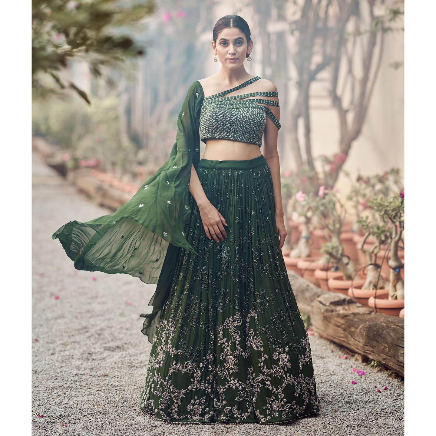 Phulwari . Andleeb seen here in pine needle green cutdana lehenga set. The intricate all over sparkling detail on this entire garment makes it a great piece for cocktails and sangeets . The blouse has a modernistic twist with a dupatta drape and quadruple straps.  To shop our new collection Phulwari  DM us or Whatsapp us on +91 6302 878 533 2021-06-27