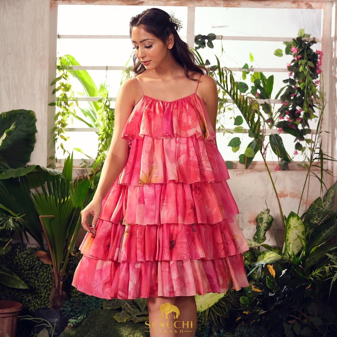 Playful easy-breezy and comfortable a ruffle dress is all you need to elevate your wardrobe and a statement piece to it. From breaking a leg on the dance floor in your next party to chilling with girl gang  some ruffles is all you need!  2021-06-27