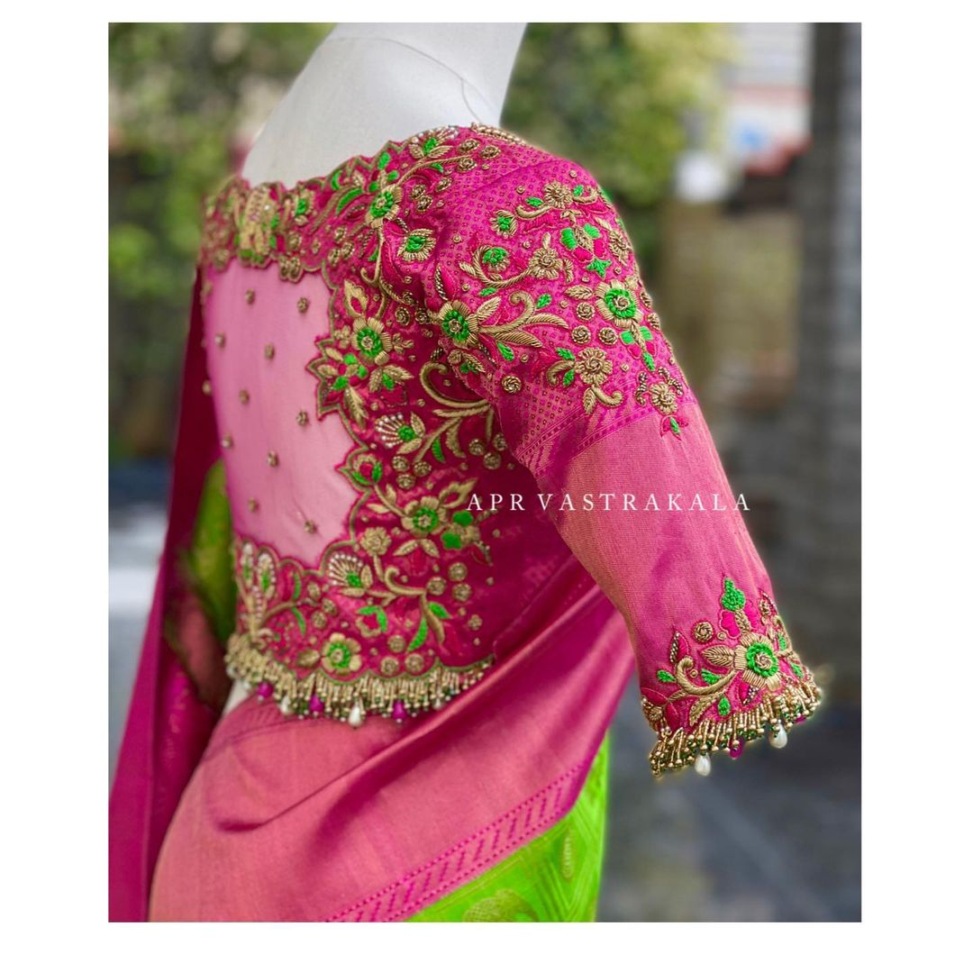 Exclusive blouse detailings!! Stunning pink color wedding blouse with elephants floral and creeper hand embroidery maggam work.     2021-06-27