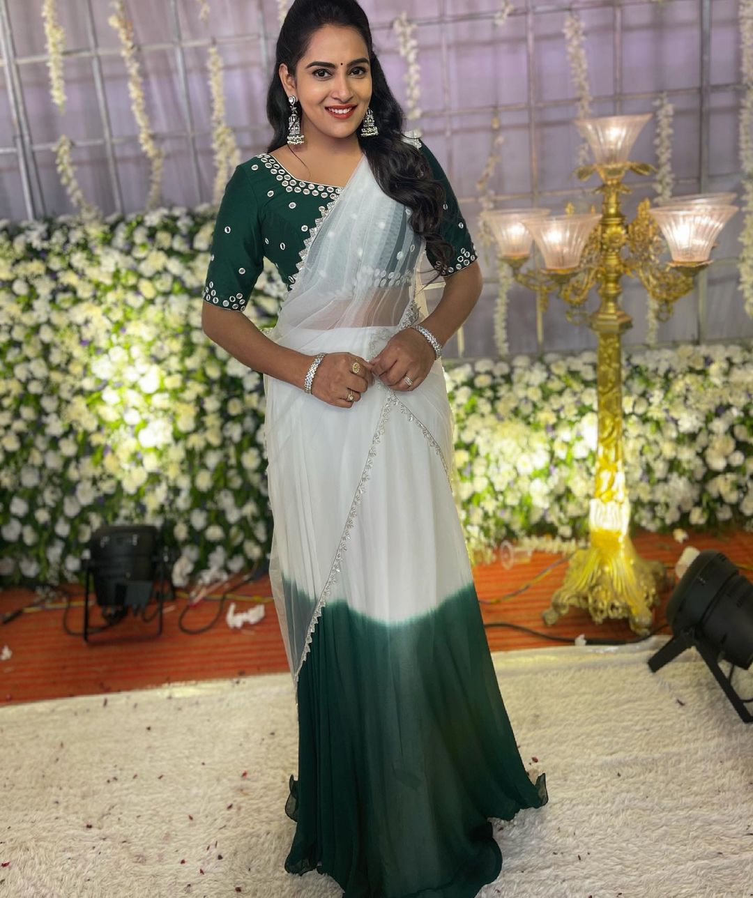 Beautiful actress Himaja in pearl white and bottle green combination net halfsaree. Blouse with silver thread hand embroidery work. 2021-06-28