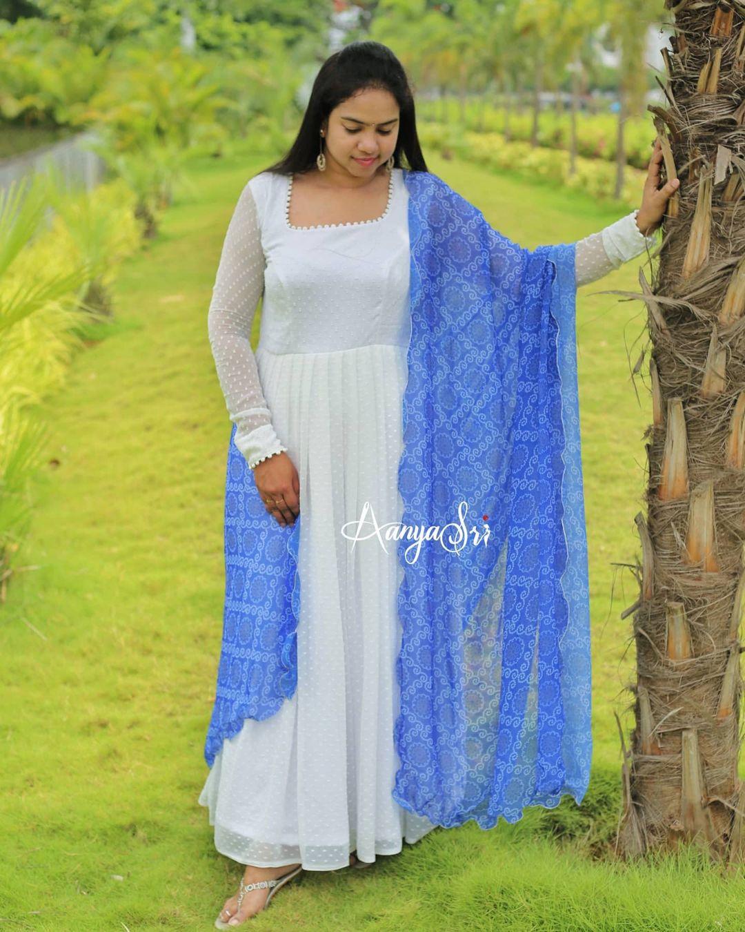 Beautiful white long frock with blue bandhini dupatta. 2021-06-28