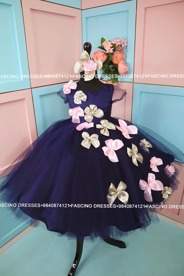 A navy blue ballgown with pink and grey silk butterflies. A creation from Fascino  Wats app or inbox to order 9840874121. Can customize in any color / size . 2021-06-29