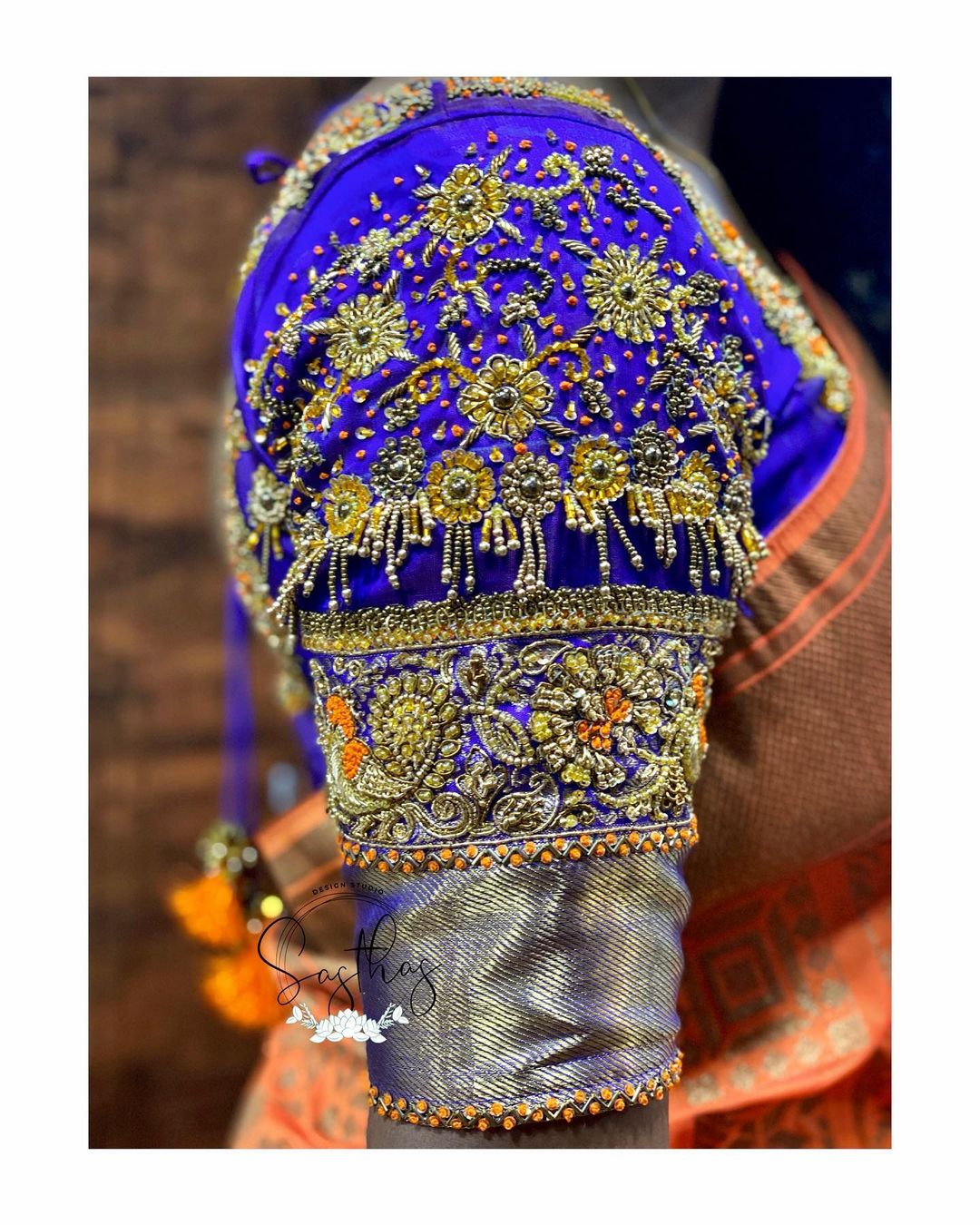 Stunning royal blue color bridal blouse sleeve with floral hand embroidery  aari and zardosi work. 2021-06-29