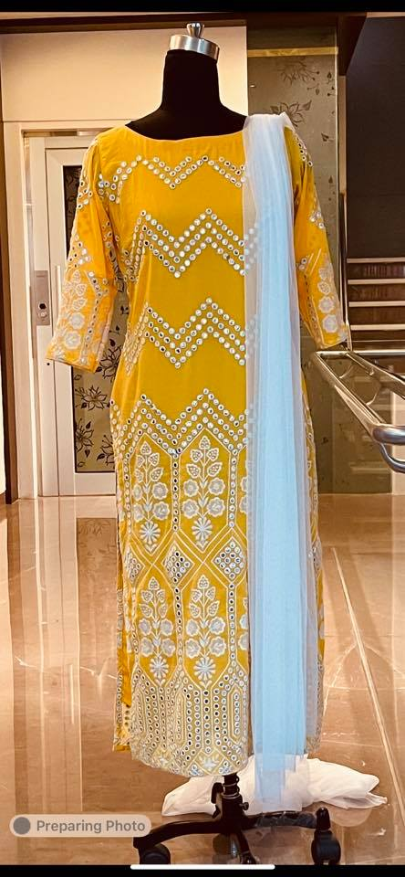 Beautiful yellow Georgette kurti with mirror work. Fabric : Georgette mirrors . Price : 4500 INR. To order WhatsApp 7013728388 2021-07-01