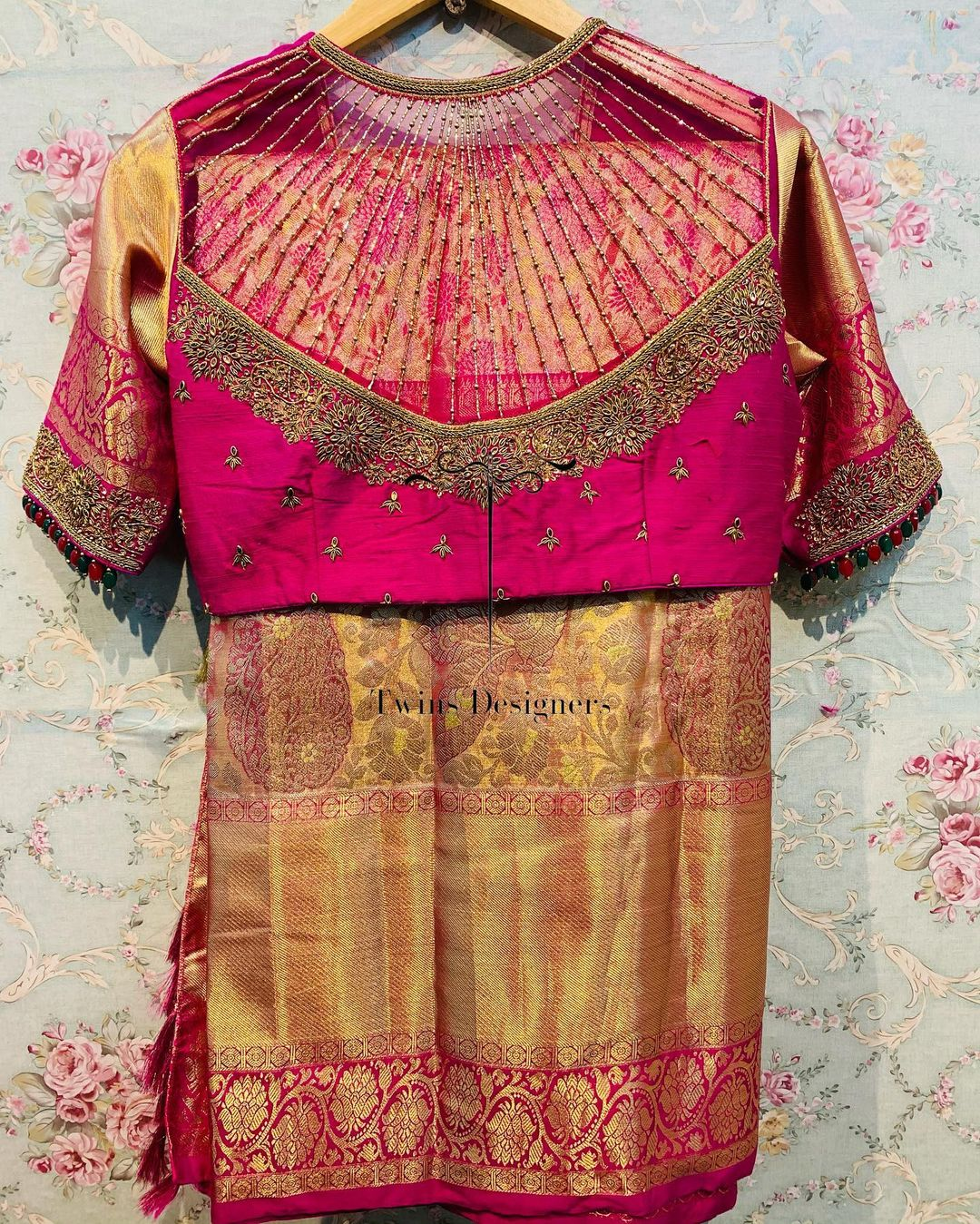 Customised maggam work bridal blouse back with bead strings and gold zari sleeves. 2021-07-01
