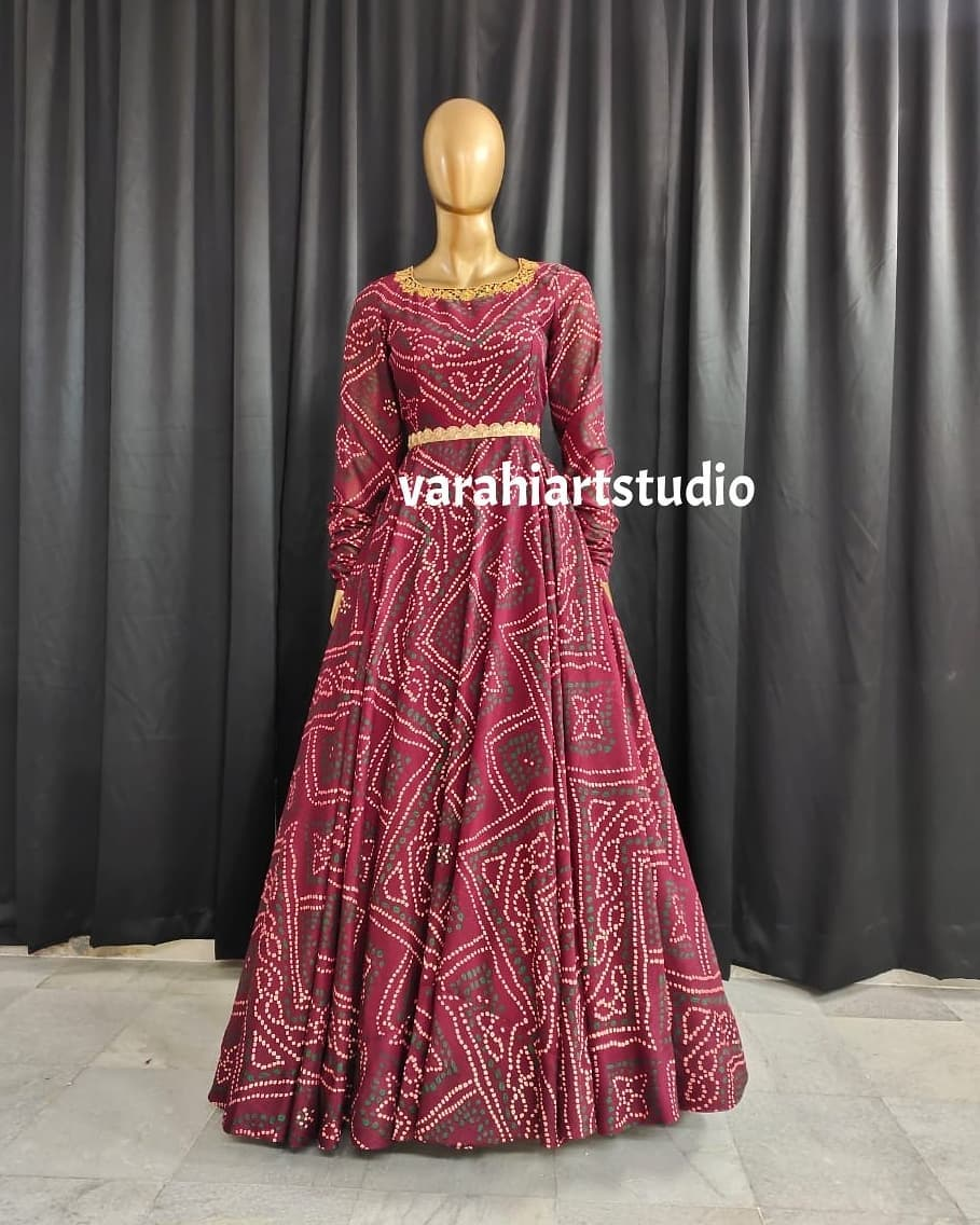 Beautiful bandhini long frock with embroidery work on neckline and waist line.  This outfit is Available @5200 . 2021-07-01