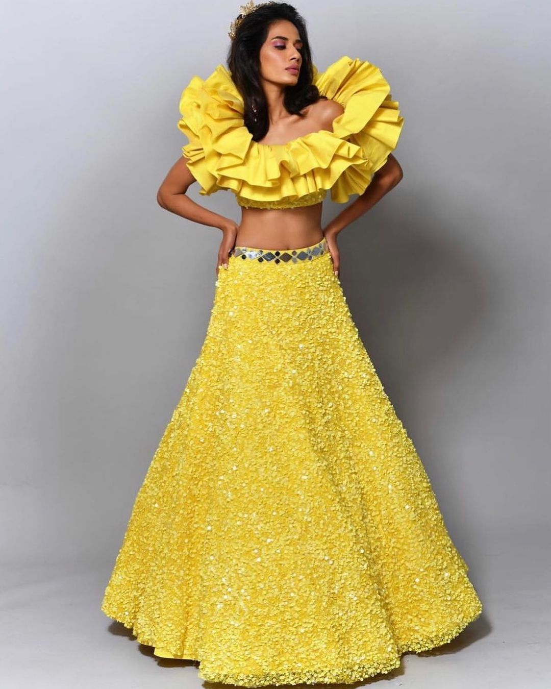 Stunning yellow color sequin skirt and off shoulder ruffle crop top. 2021-07-01