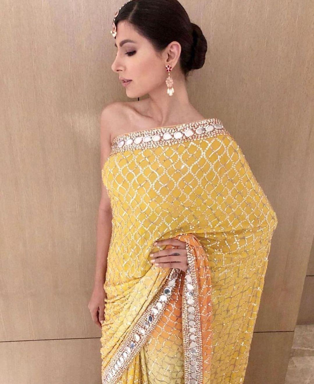 Beautiful yellow color designer saree with sequin work. 2021-07-02