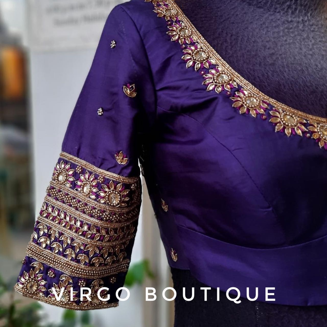 The closed neck purple blouse with intricate hand embroidery! Stunning purple color bridal blouse with floral hand embroidery silver thread and kundan aari work.  2021-07-03