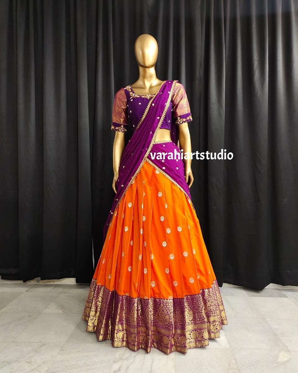Gorgeous mustard yellow pattu lehenga and purple color blouse with net dupatta. Blouse with hand embroidery maggam work.  2021-07-05