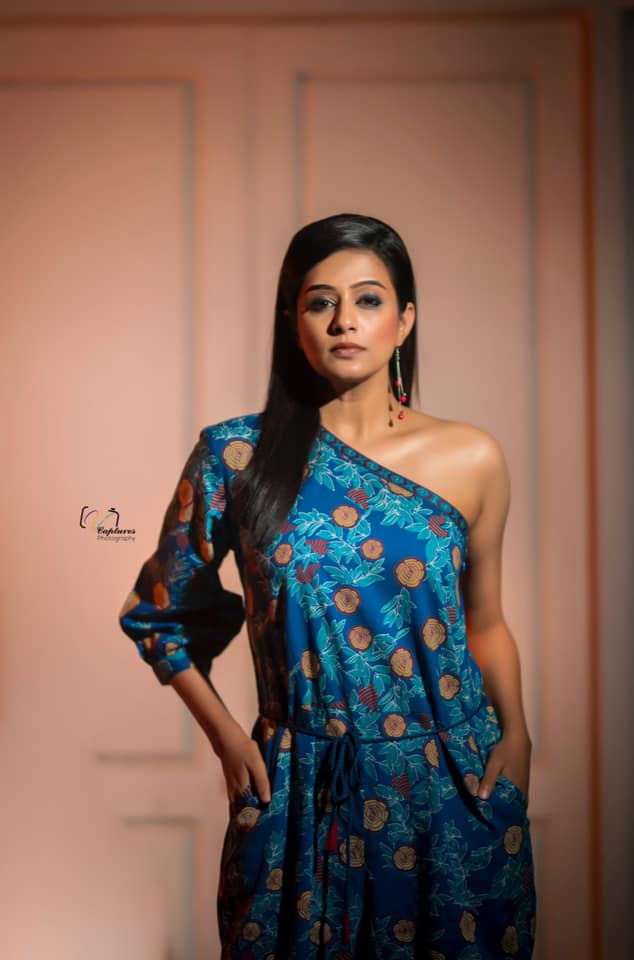 Beautiful actress Priyamani in floral one shoulder jumpp suit. 2021-07-07