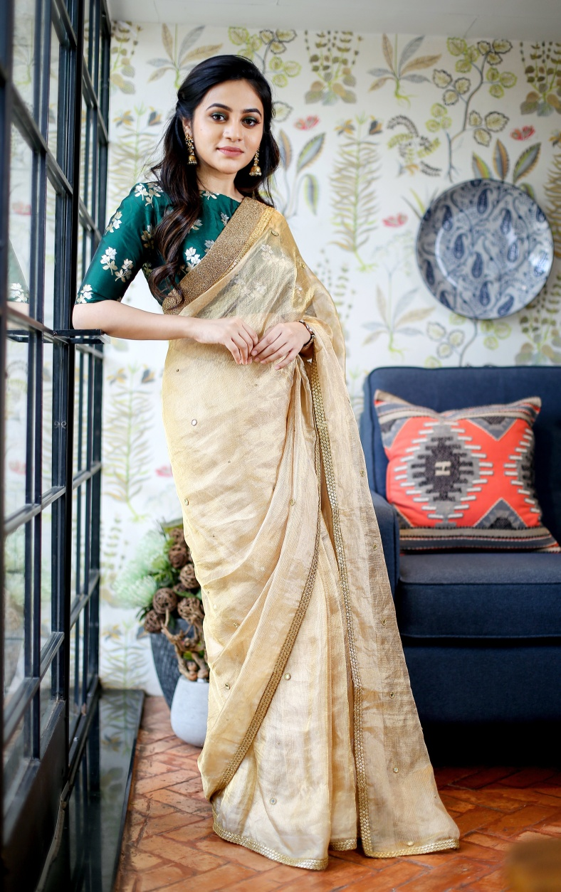 Gold Tissue saree. Hand embroidered gold tissue saree finished with readymade border. Saree comes with plain unstiched blouse fabric .  Brocade blouse material will be at additional cost .  Place your orders now!  For orders and queries please whatsapp  on  9952093562 or Reach  on 044 4262 4085. 2021-07-07