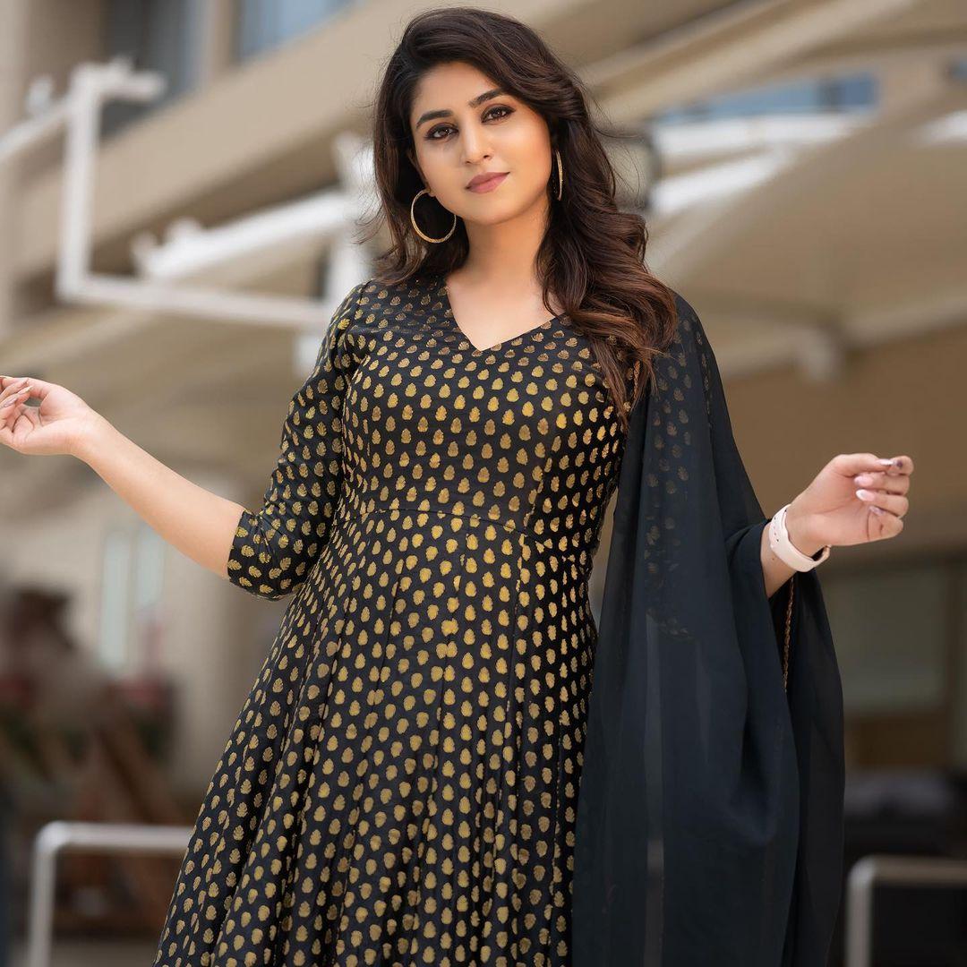Beautiful actress Varshini Sounderajan in black brocade floor length dress. Costume Navya Marouthu. 2021-07-07