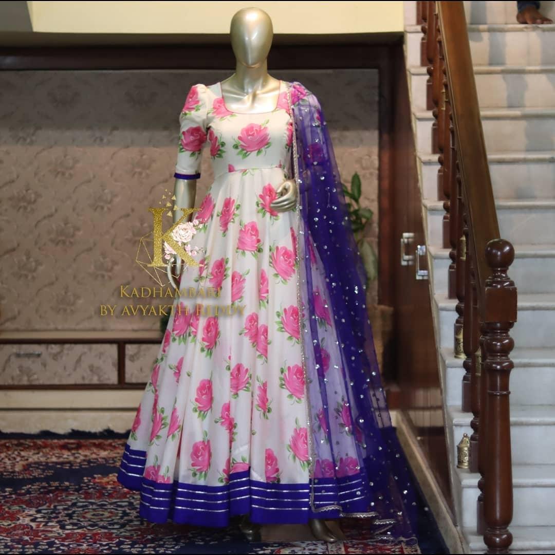 Stunning pearl white color rose floral floor length anarkali with blue net dupatta.  2021-07-07