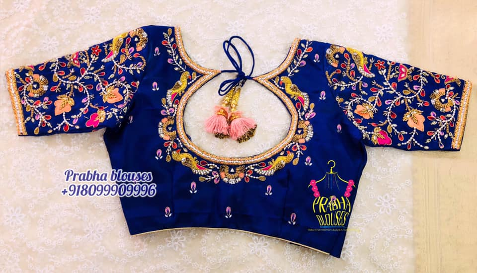 Lovely deep blue color bridal blouse with parrots and creeper hand embroidery maggam work.  2021-07-09