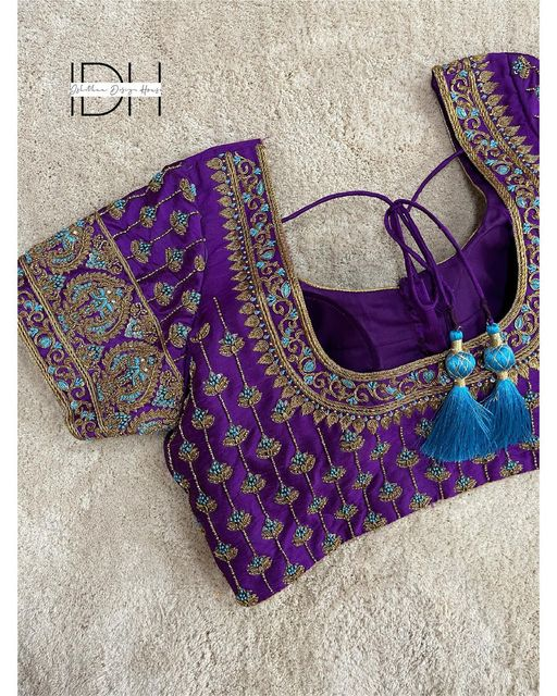 The beauty of purple !  Pretty purple color bridal or muhurtham blouse with floral and creepers heavy zardosi work. 2021-07-09