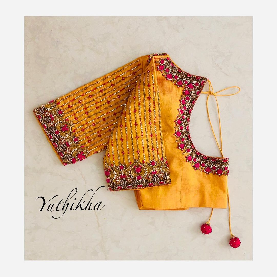 Stunning yellow color bridal blouse with bead and thread aari work on neckline and sleeves. 2021-07-09